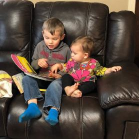 """Jed reading to Adi. Jed and Adi got along very well. Adi loves Jed for some reason but I'm not complaining. Thanks to Jed, Adi now thinks it's the coolest thing to hit herself in the head while saying """"Ow."""""""