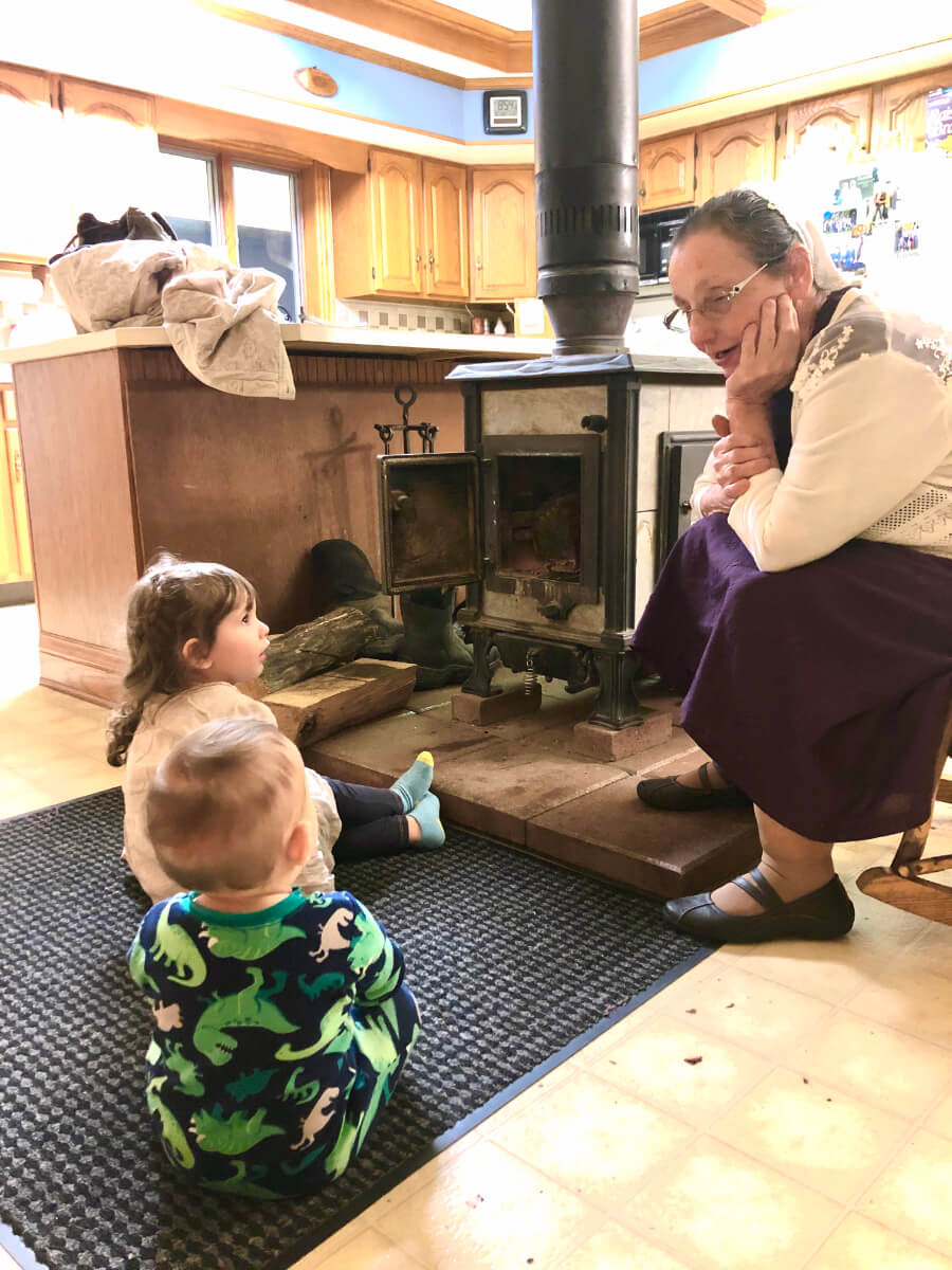 Adi and Elliot soaking up wisdom from Grandma Detweiler while enjoying the warm fireplace at Uncle Ray's house.