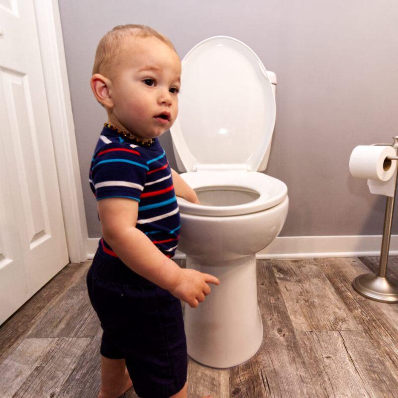Elliot Snader plays in toilet