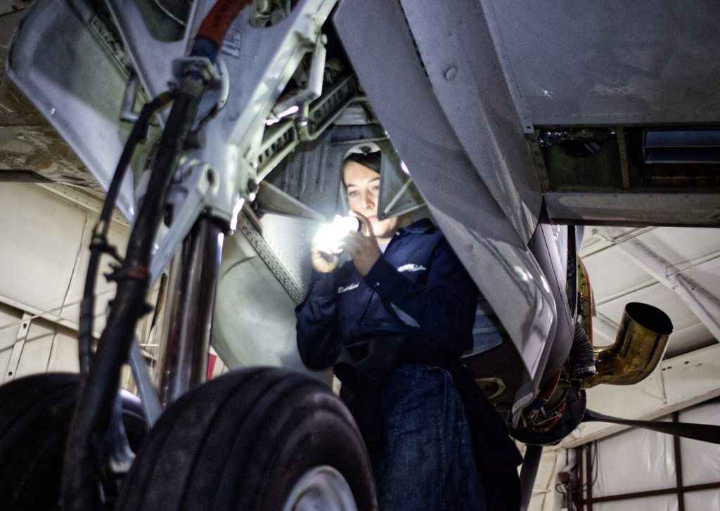 Performing inspection in a Super King Air 200 wheel well at MMS Aviation